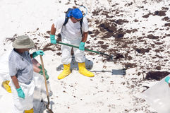 Oil washes ashore in Pensacola Beach. PENACOLA BEACH - JUNE 23:  BP oil workers attempt to clean huge amounts of oil  washed ashore on Pensacola Beach, FL on Stock Photo