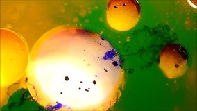 Oil, water and ink mixing stock footage