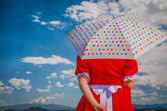 Lady in Red with umbrella Royalty Free Stock Photography