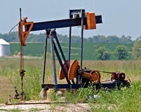Oil Well. Illinois oil well in a farm field royalty free stock images