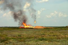 Oil Well. Burn out of oil well in steppe stock image