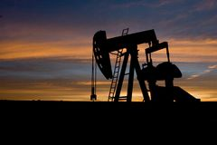 Oil well. An oil well at sunrise in Eastern Colorado Royalty Free Stock Photography
