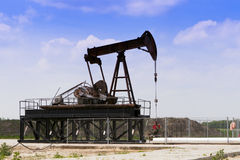 Oil well in the blue sky. Stock Photo