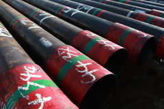 Oil well casing laying on the main deck. On the drilling rig royalty free stock images