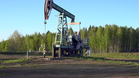 Oil-well derrick working in Russia stock video