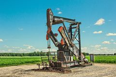 Oil well. An oil well in Falmouth, Michigan royalty free stock photography