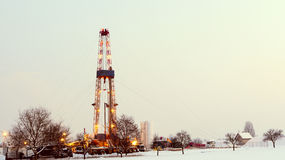Oil well in the field, sky. Stock Photo