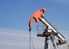 Oil well gas and gasoline well against the blue sky, close-up, Extraction of petroleum, equipment, extraction, environment royalty free stock photo