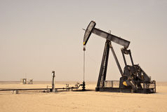 Oil Well Horse Head Pump. Also referred to as a Nodding Donkey; pump jack Royalty Free Stock Photography