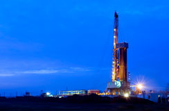 Oil well at night. Lighting the outdoors stock images