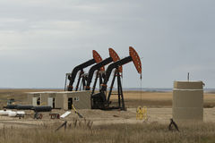 An Oil Well in NorthDakota. An active pumping oil well in North Dakota Royalty Free Stock Images