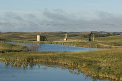 An Oil Well in NorthDakota. An active pumping oil well by a wetland in North Dakota Stock Photo
