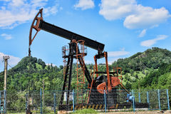 Oil well pump. Extractive oil industry equipment, oil well pomp, non-environmental and non-organic concept royalty free stock photography