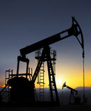 Oil well pump. Extracting,oil field stock photography