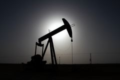 Oil well. Pump installed in the desert Stock Photos