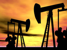 OIL WELL PUMP JACKS AT SUNSET Stock Photo