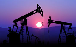 Oil well pump. Oil well plant against sunset stock photography