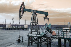 Oil well pump. Toned. Royalty Free Stock Photo