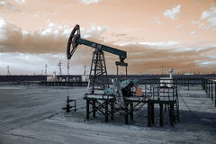 Oil well pump. Toned. Stock Photos