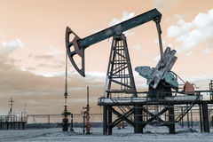 Oil well pump. Toned. Royalty Free Stock Images