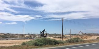 An oil well pumps crude out of the fields, California.  royalty free stock photos