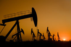 Oil well Silhouette. Silhouette of oil well with beautiful sunset Royalty Free Stock Images