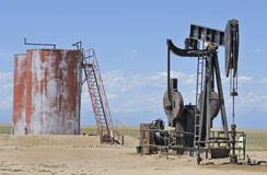 Oil well and storage tanks Stock Photo