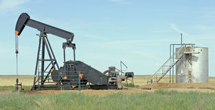 Oil well and tank. Traditional oil well and tank stock photo