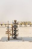 Oil well wellhead in Bahrain oil field. A wellhead is the component at the surface of an oil or gas well stock photo