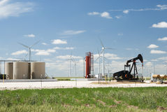 Oil well and wind farm. An oil well next to a wind farm in Texas Royalty Free Stock Photos