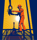 Oil well worker hoisting. Vector illustration of an oil well worker at work on a platform Royalty Free Stock Photo