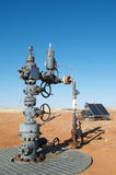 Oil Wellhead. In the Australian outback; solar panel in the background Stock Photography