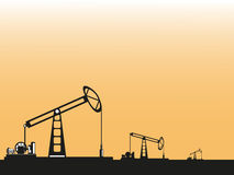 Oil wells in the desert. Vector illustration. Black and white illustration on an orange background Royalty Free Stock Images