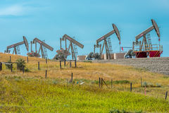 Oil Wells. North Dakota oil industry. Wells on Route 68 between Sidney MT and Watford City ND Stock Photo