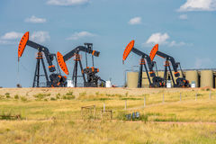 Oil Wells. North Dakota oil industry. Wells on Route 68 between Sidney MT and Watford City ND Stock Image