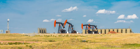 Oil Wells. North Dakota oil industry.   Wells on Route 68 between Sidney MT and Watford City ND Stock Photography