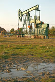 Oil wells with pollution Stock Images