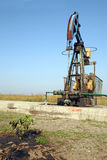 Oil wells with pollution Stock Photo