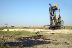 Oil wells with pollution Stock Image