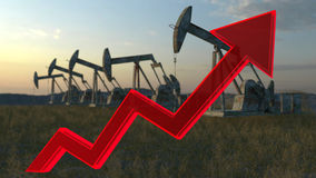 Oil wells - the price of oil rising up Stock Image
