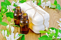 Oil and white soap with flowers of honeysuckle Stock Image