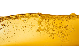 Oil on White. Yellow liquid (oil or petrol) with bubbles on white Royalty Free Stock Image