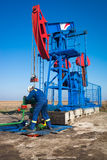 Oil worker check oil pump Stock Images