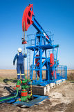 Oil worker check oil pump Royalty Free Stock Photography
