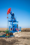 Oil worker check oil pump Royalty Free Stock Image