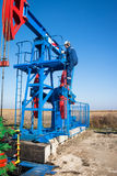 Oil worker check oil pump Royalty Free Stock Images