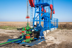 Oil worker check oil pump Stock Image