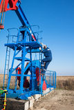 Oil worker check oil pump Royalty Free Stock Photos