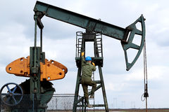 Oil worker climbs Stock Image