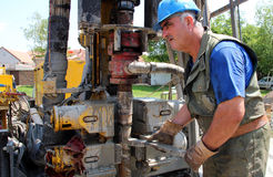 Oil Worker Drilling For Oil on Rig. Worker operating machinery on oil rig. Selective focus Stock Images
